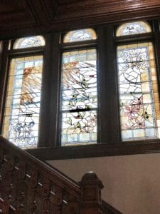 Antique Stained Glass Brightens the Grand Staircase of Castle La Crosse